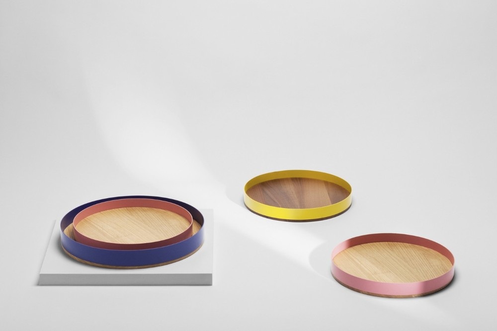 'Barrel trays' by Tino Seubert for H Furniture. Two different sized ash, oak or walnut bases are combined with metal rings in white, green, blue, yellow, pink, red, black or grey.