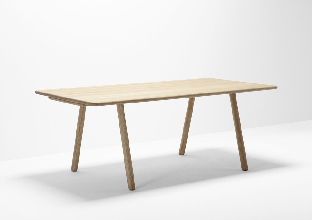 The 'Curved' table in oak. With a soft rounded look, the table uses an unusual trestle leg base and removable top. The table is available in ash oak or walnut - either left natural or oiled.