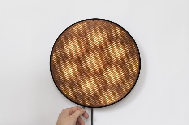 David Derksen's explorations into moire jewellery have culminated in the 'Moire' wall light for New Works. By moving a small lever around the circumference, different types of moire patterns emerge.