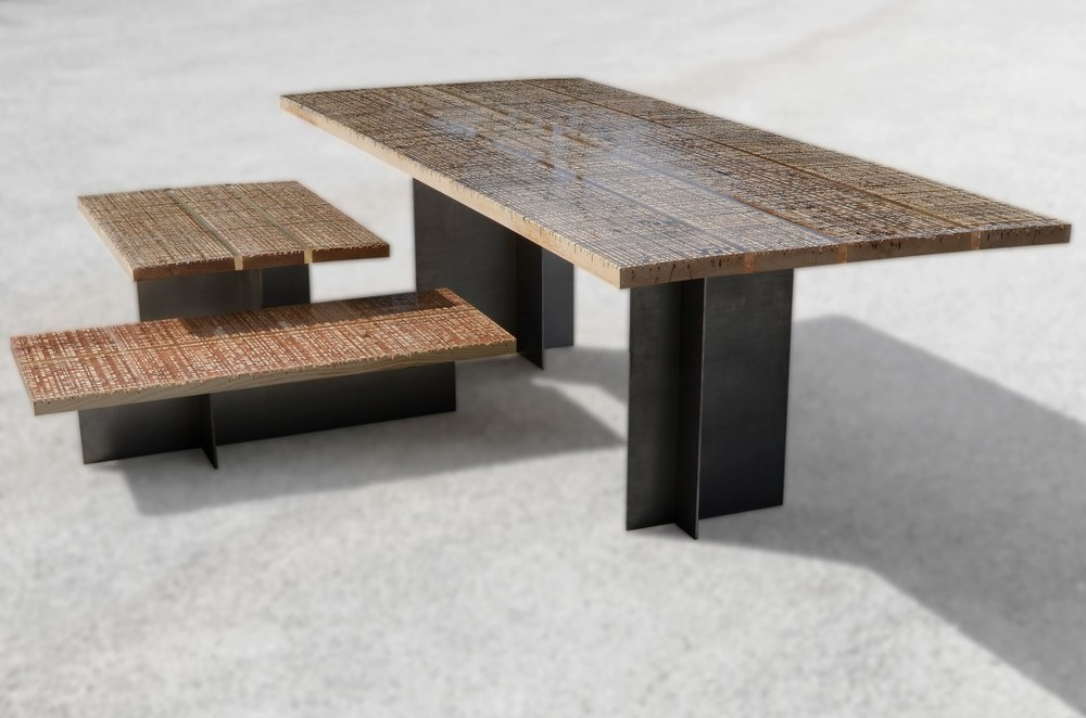 Alcoral's 'Marbleways' tables combine sheet steel legs and planks from marble cutting coated in resin.