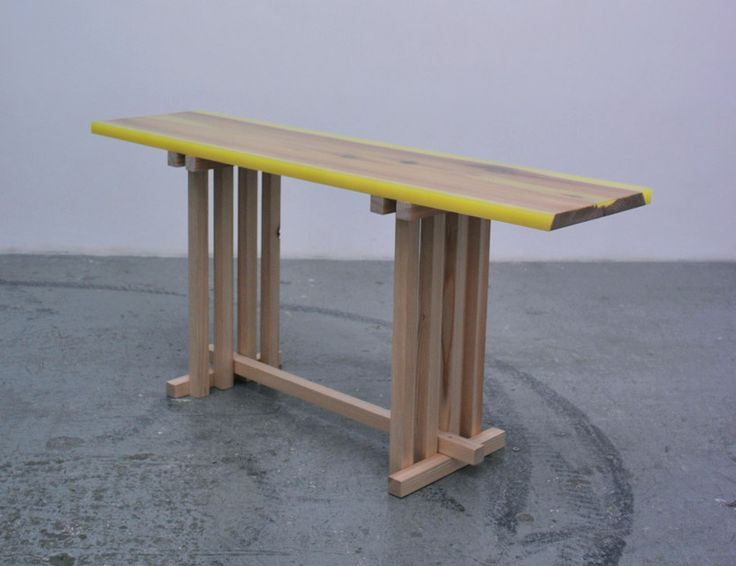 'Flat-Table-Peeled' by Jo Nagasaka encases douglas fir planks with flourescent resin edges.
