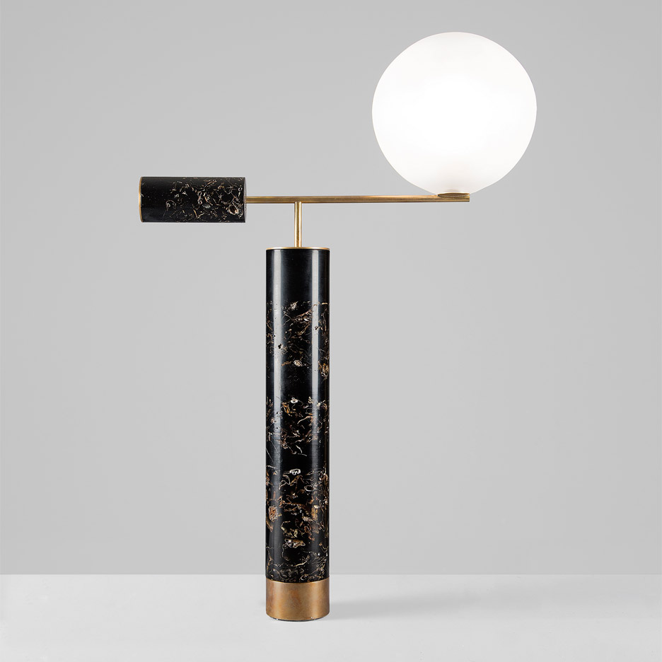 'Flora' lamp by Marcin Rusak - cylinders of black resin with brass details balanced by a opalescent glass ball