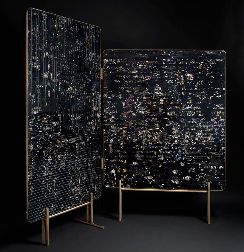 'Flora' screen by Marcin Rusak. Slivers of resin cut from blocks with real flowers embedded in it are wrapped by a fine frame of tarnished brass.