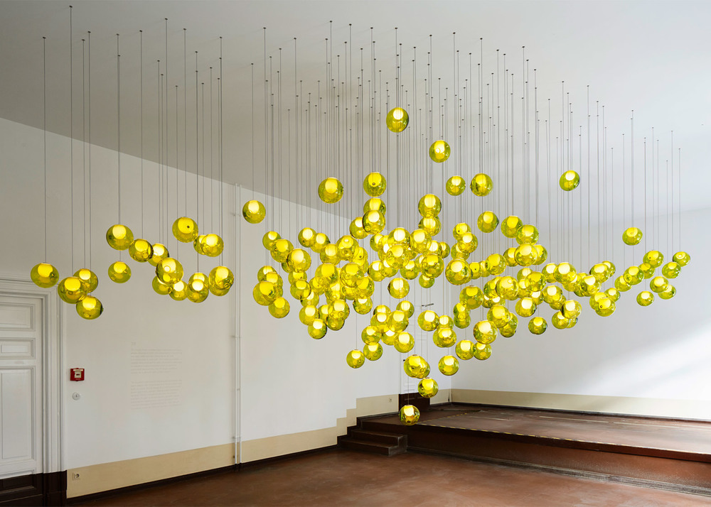 Bocci 79 featuring a cluster of yellow '14' lights, the first highly successful lighting design under the Bocci name released in 2005.