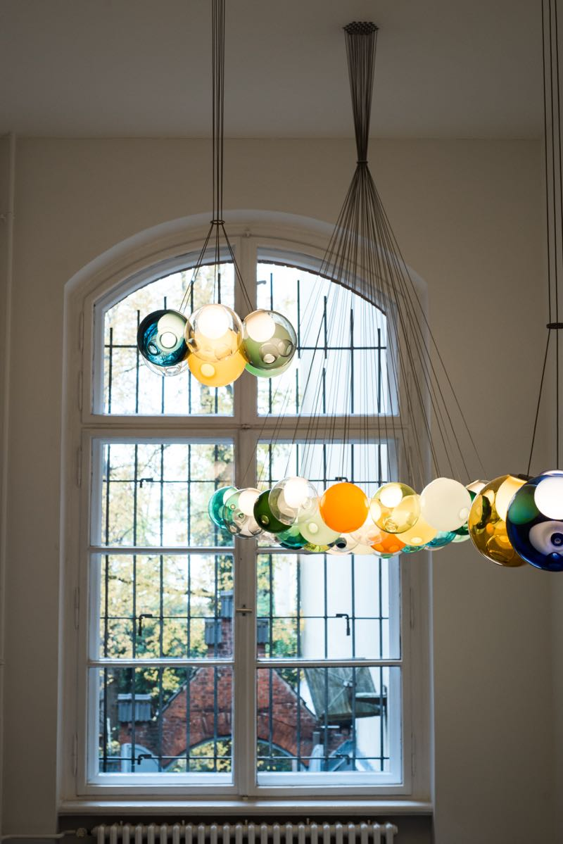 A multi-coloured cluster of Bocci '28' lights presented in a chandelier form from fine wires. Photograph by Harry Fricker.