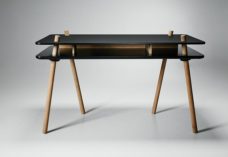 The 'Stilt' desk by Steffensen & Würtz (Thomas Steffensen and Pia Würtz Mogensen) for Won Design. Oak legs penetrate the black lacquered table top and create storage compartments between the two layers.