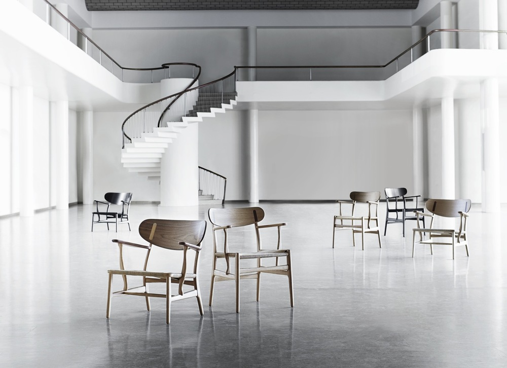 Carl Hansen CH22 chair by Hans Wegner. Reissued along with the matching CH26 dining chair never previously released. The brand also opens a new showroom.
