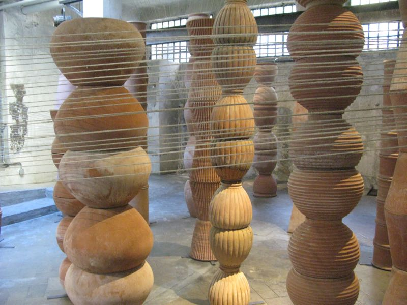 A corner of Antonio Marras' instalation  Terra Cotta Labirinti e Fili     in Tortona. Terracotta ceramics and 20 kilometres of string came together.