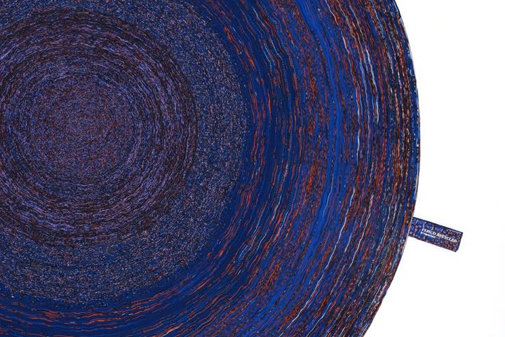 Simone Post's contemporary rag rug for Label Breed - a spiral of reject fabric strips.