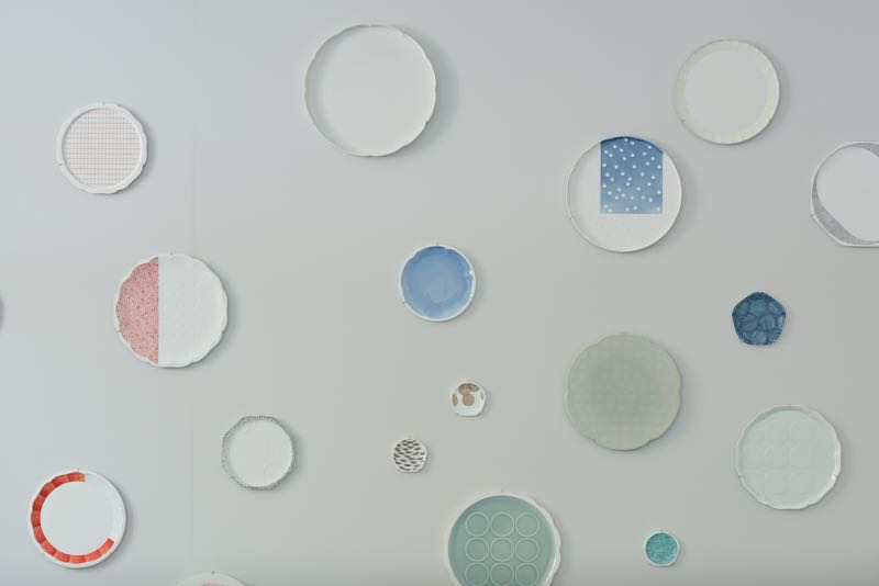 An installation of plates with patterns and glaze colours devised by Scholten & Baijings, the curators of the 2016Arita project.