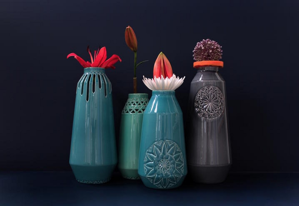 A set of 4 vases by Anny& at Masterly.