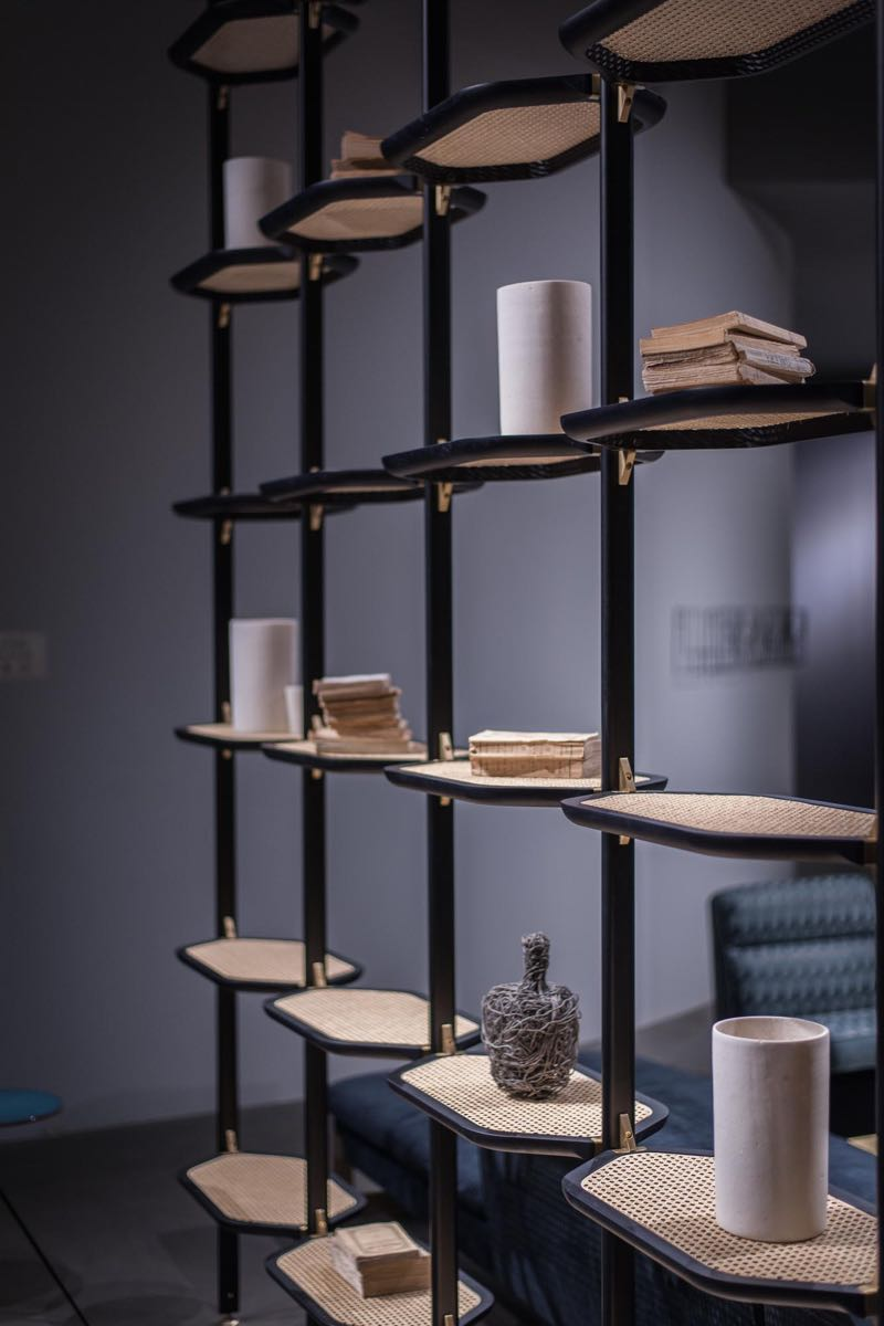 Shelving by Pietro Russo for Baxter with  woven wicker shelves and brass details.
