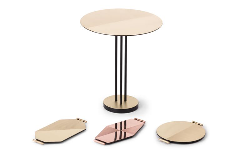 Italian brand Mingardo launched 'Satin' a range of geometric trays in copper and brass by Chiara Andreatti along with a delicate side table with brass top by the same name.