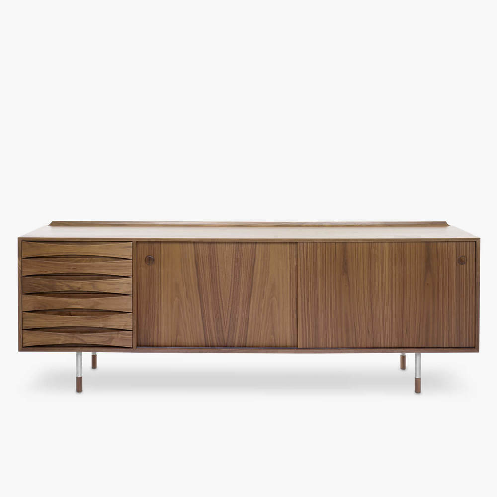 The Arne Vodder sideboard was reissued under license after Anton Assaad, of Australian brand Great Dane Furniture, spent many years in consultation with the Arne Vodder family in Denmark to ensure the production was of the highest standard. This and many other Vodder designs are now copied by replica dealers. They pay no royalties to the Vodder family.