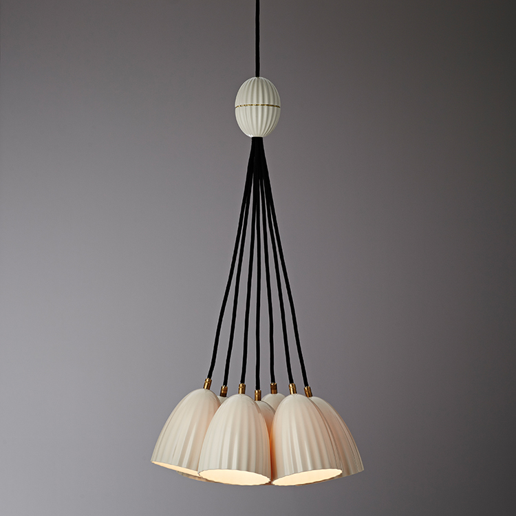 The 'Eido' pendant by Porcelain Bear presented as a seven lamp cluster.