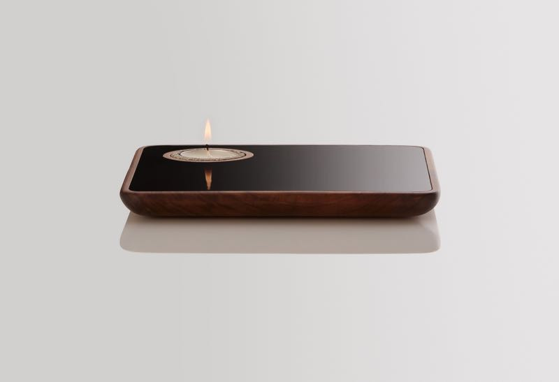 'Float' by Marcus Piper is a range of small objects and lights that utilise the same timber form in several different ways. Shown here is the tray with integrated tealight holder.