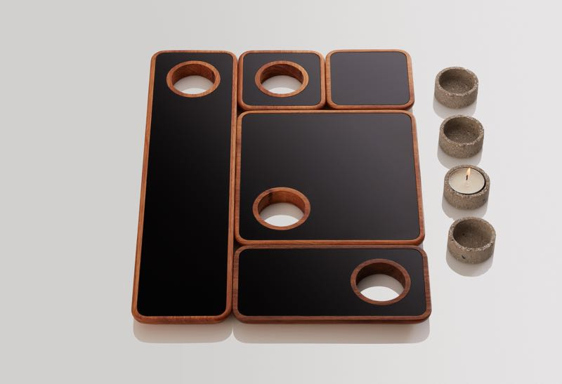 Marcus Piper's 'Float' trays with built in areas to house tealights.