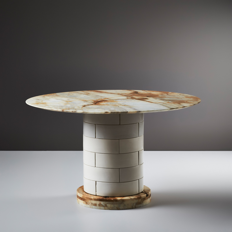 An example of the 'Metro' dining table with a more heavily veined stone base and top in Giallo Sienna marble.