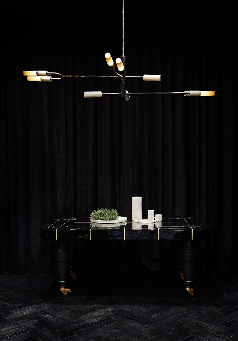 The 'I-O-N bident' pendant light with custom 'Metro' bench below.