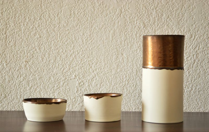 Able Nouamani's 'Ceramic Experiments' with bronze glazes applied to simple porcelain forms.