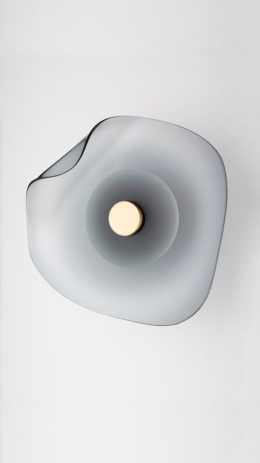The grey version of the 'Melt' wall sconce by Articolo Architectural Lighting.