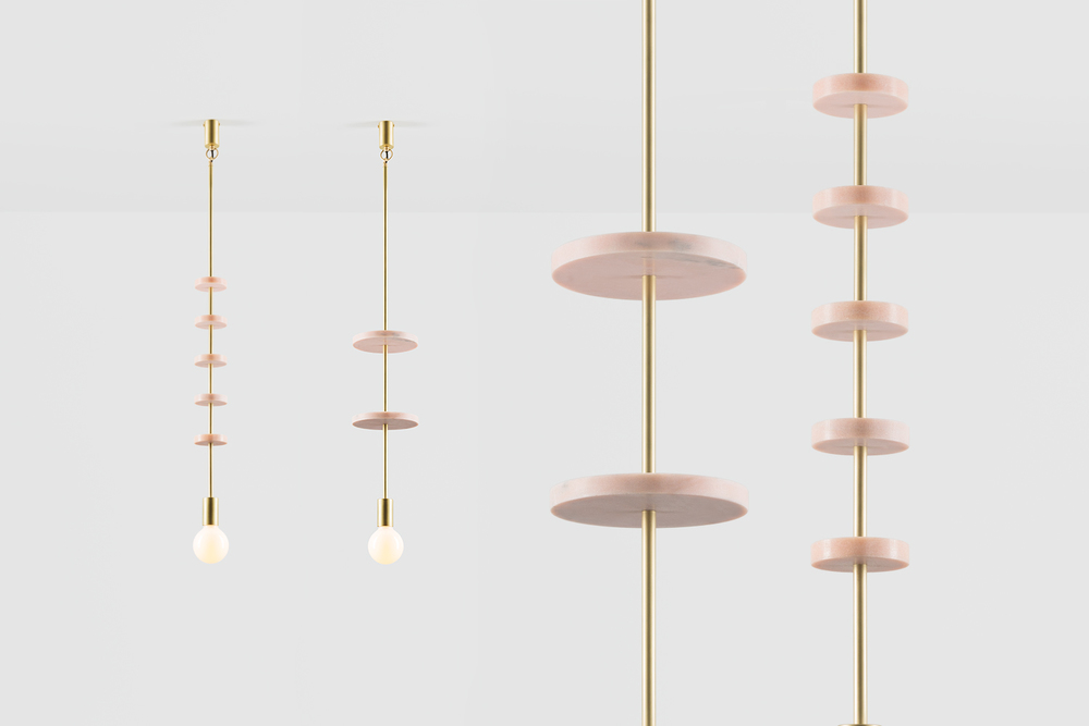 Volker Haug's 'Discus' pendants in polished or brushed brass with pink marble elements.