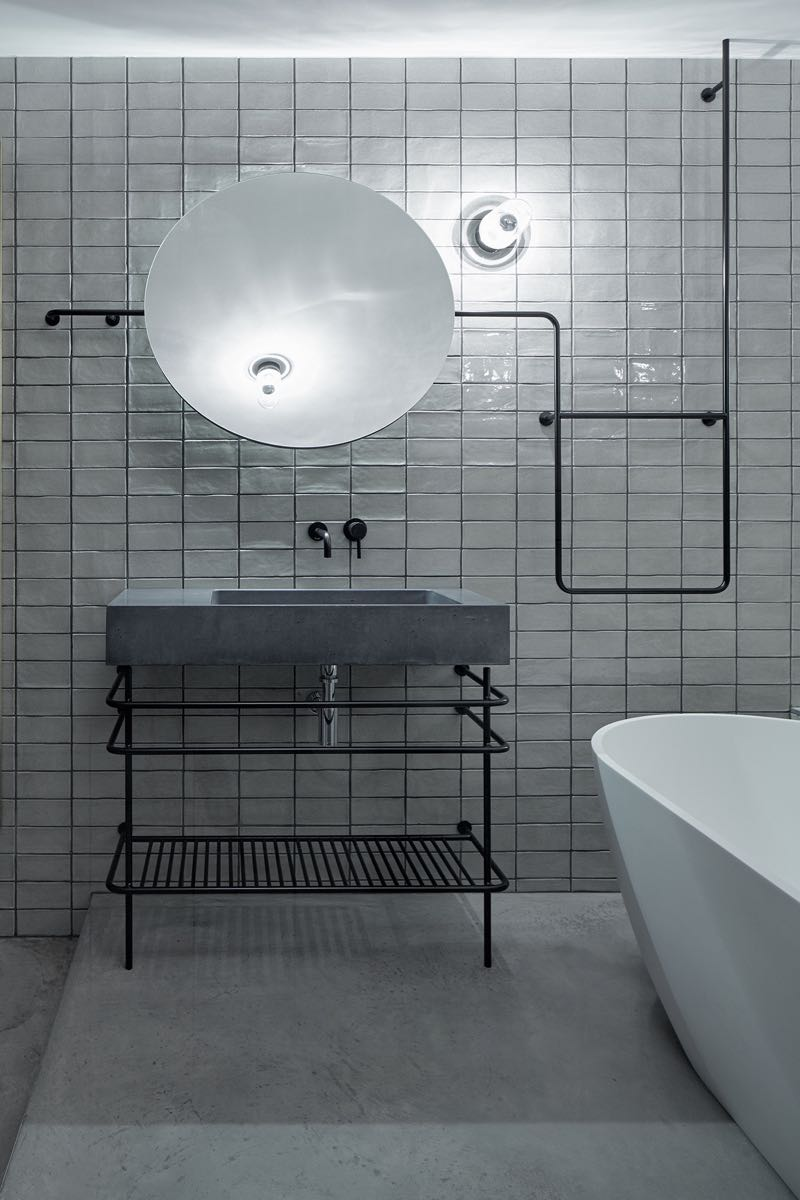 A concrete washbasin from  Gravelli with lighting by Zangra.