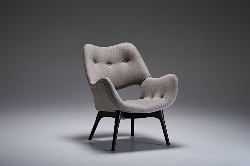 The 'B210H TV' chair from circa 1953. Smaller than the the 'Contour 230' it uses the same timber base and turned leg.