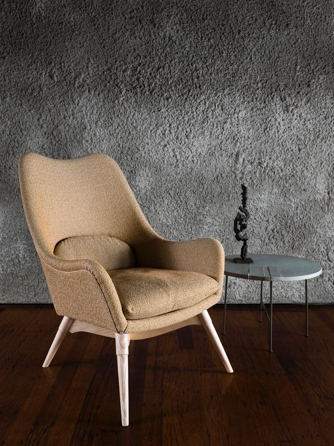 The 'E254 Elastic Suspension' chair from circa 1954. Narrower than the 'Contour', the E254 adds lumbar and seat cushions