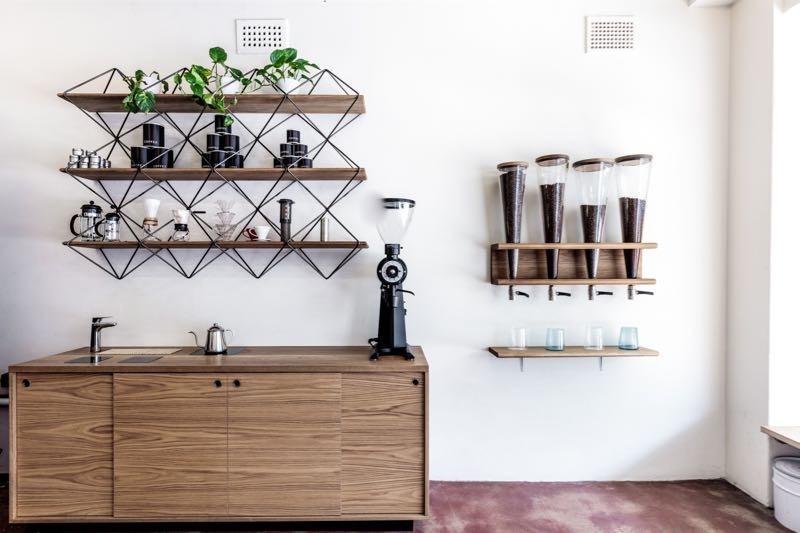 Metal and walnut shelving designed and made by Christian Hall, storage and other fine pieces in solid walnut by Liam Mugavin for Coffee Bondi Beach. Photograph by Barton Taylor.