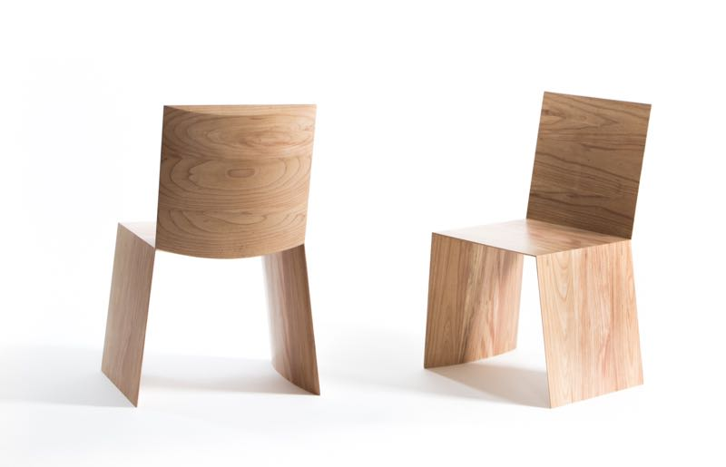 Mugavin's 'Hamra' chair defies standard construction principles. Just 3 joints hold together what appears to be folded wood.
