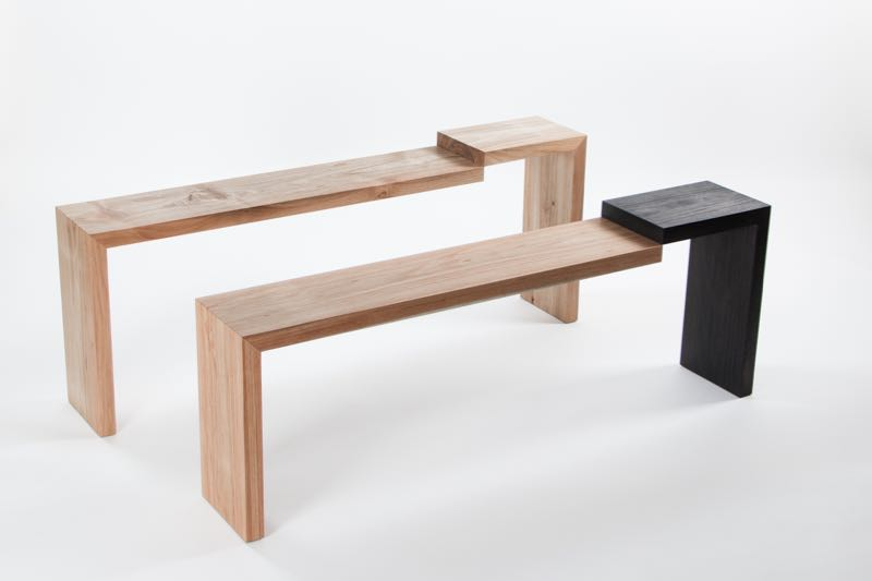 The 'Step' bench in black stained & natural Tasmanian silver wattle, appears impossible but relies on a hefty tongue of timber hidden beneath the seat that tie the two parts together. T here is a visual trick  at the core of many of Mugavin's designs.