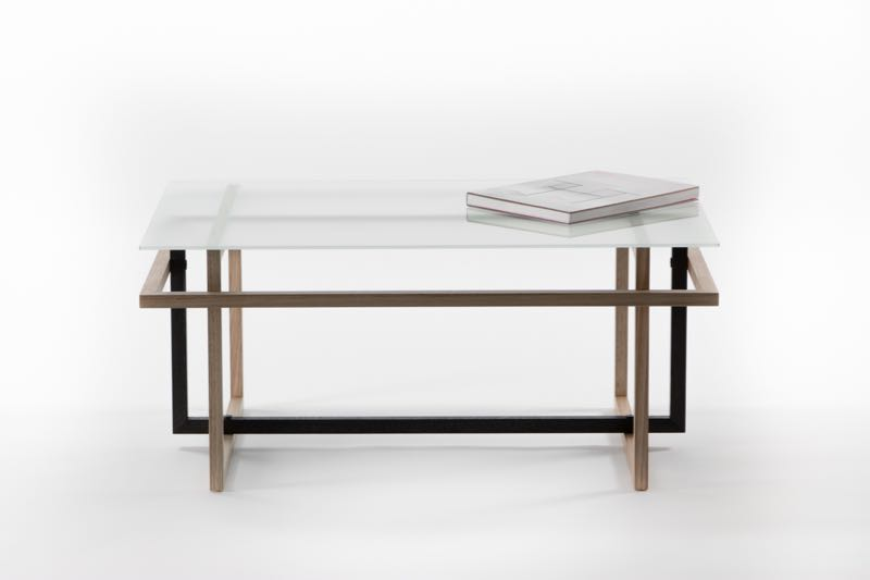 The 'Framed' table uses three rectangles of Tasmanian oak and a sheet of sandblasted toughened glass that lay flat in a thin box for cost effective transport. The design was influenced by the early modernists: Rietveldt, Wright and Mackintosh.