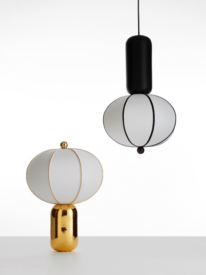 Another design by Matteo Zorzenoni for MM Lampadari, the 'Balloon light' is available as pendant or table lamp in gold or matt black glazed ceramic. The shade is a stretched textile.