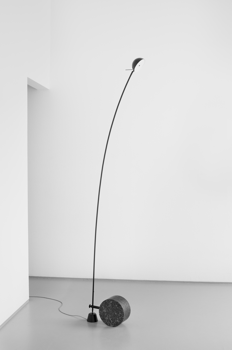 The 'Ariel' floor light by Norwegian designers Bjorn van den Berg & Falke Svatum comes in black or white. The position of where the stone base meets the arm can be adjusted to make the light more vertical.