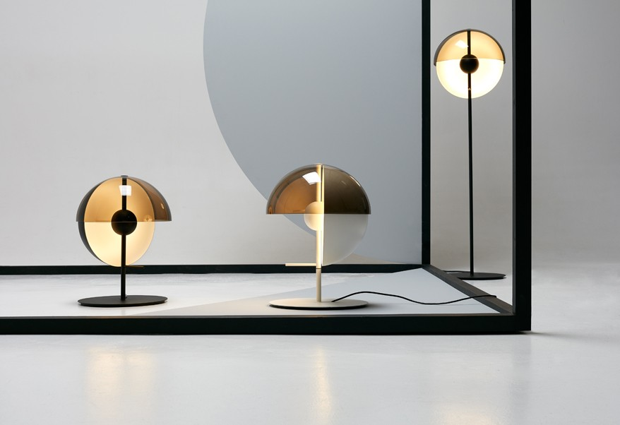 The 'Theia' floor and table lamps by Mathias Hahn for Spanish brand Marset. The design features a double shade, one in spun aluminium and the other in PMMA (a type of clear hard plastic). The inner shade can be moved through 90 degrees.