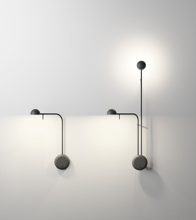 The 'Pin' light by Ichiro Iwasaki for Vibia. The collection includes floor and table lights along with a large range of wall lights with both curved and straight arms to encapsulate a variety of different looks.