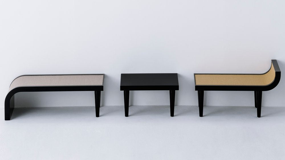 José Lévy's bench system that operates as a multiple seats and a side table when pulled a part.