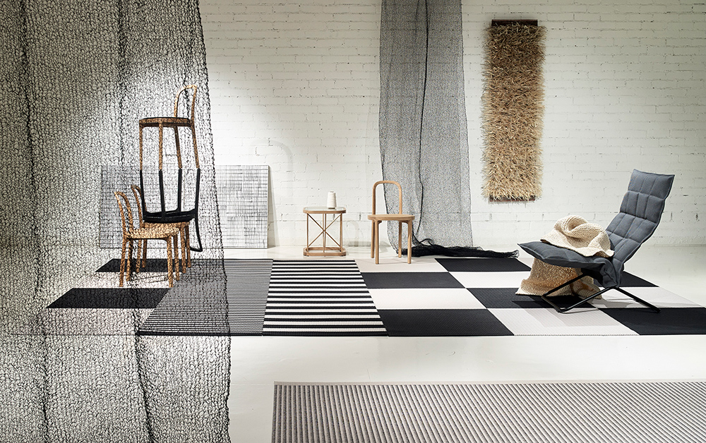 The 'Squareplay' rug by Rita Puotila for Woodnotes is made of woven twisted paper and comes in 24 colours and several sizes. Also shown is the 'K chair' (right),'Twiggy' table & 'Siro+' chair.