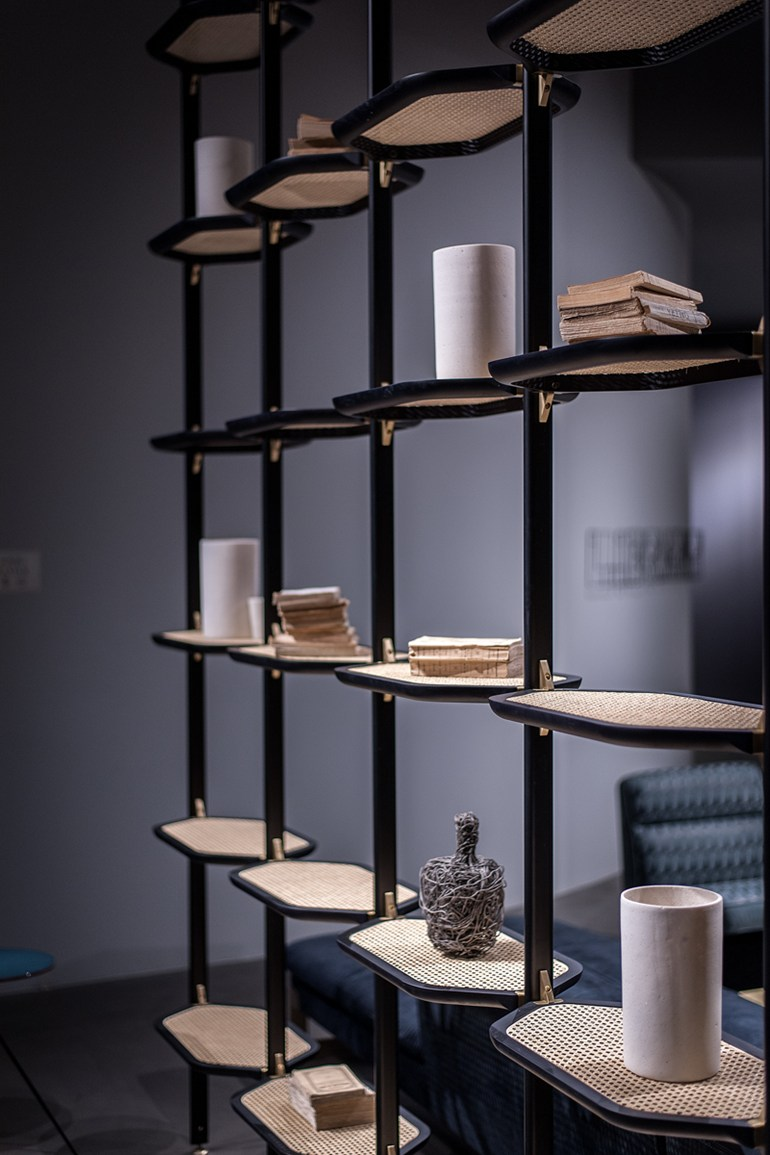 Pietro Russo's 'Libelle' floor to ceiling shelving for Baxter. The design features woven cane shelves in combination with metal uprights and ebonised timber shelf frames.