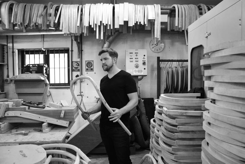 Samuel Wilkinson in the workshop surrounded by rather a large collection of bentwood chair components.