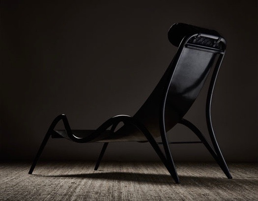 A chair from Studio Swine's  Fordlandia  exhibition made from a hard rubber called Ebonite. Photograph by Petr Krejčí.