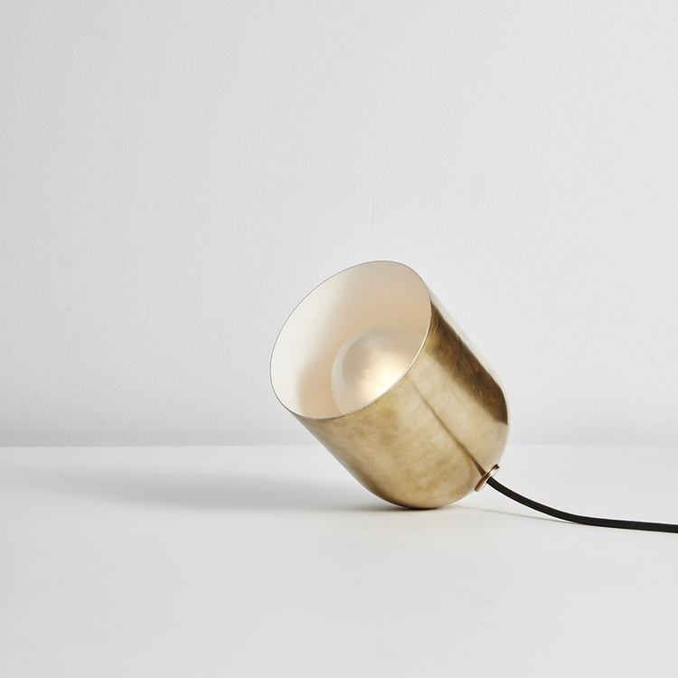 'Duomo' rocking floor/table light in whiskey aged brass by Anaesthetic.