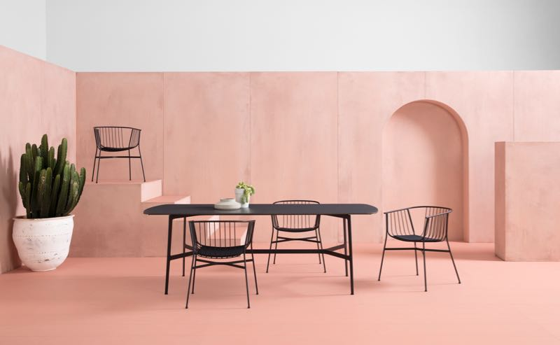 The 'Jeanette' chairs and long version of the 'Eileen' table with HPL top. Both designed by Tom Fereday for the SP01 outdoor collection. Photography by Jason Busch.