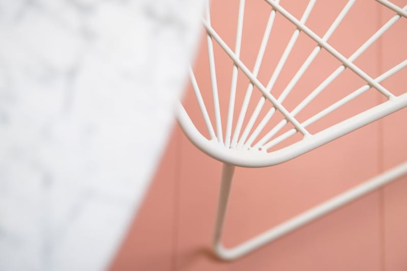 The 'Chee' chair in close-up with the Carrara marble top of the Parisi table - both designed by Tom Fereday for the SP01 outdoor collection. Photography by Jason Busch.