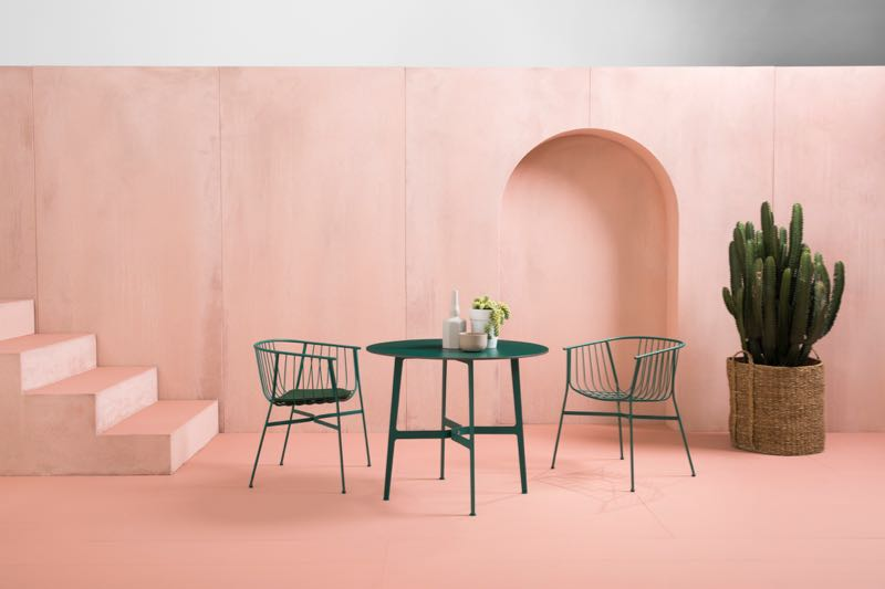 The 'Jeanette' chair in green with and without seat cushion and the circular version of the 'Eileen' table  with HPL top. Both designed by Tom Fereday for the SP01 outdoor collection. Photography by Jason Busch.