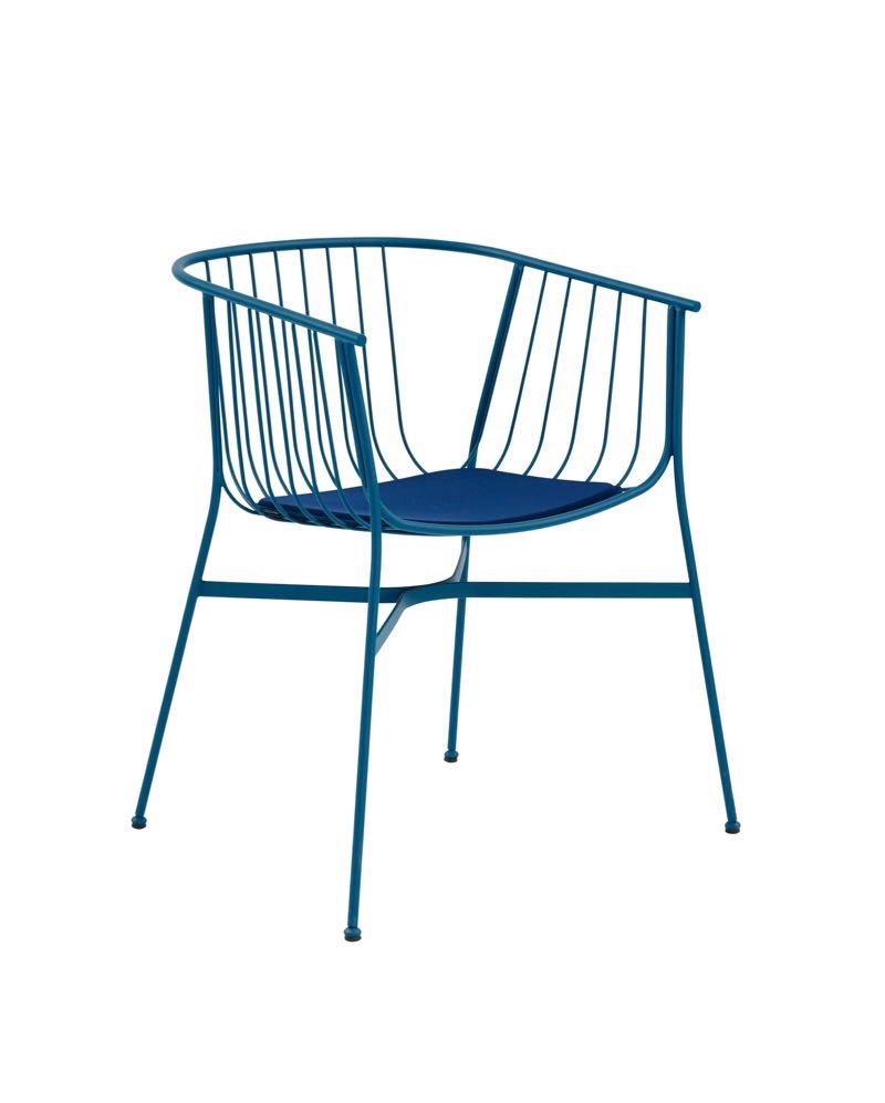 The 'Jeanette' chair in blue wit heat cushion by Tom Fereday for the SP01 outdoor collection.