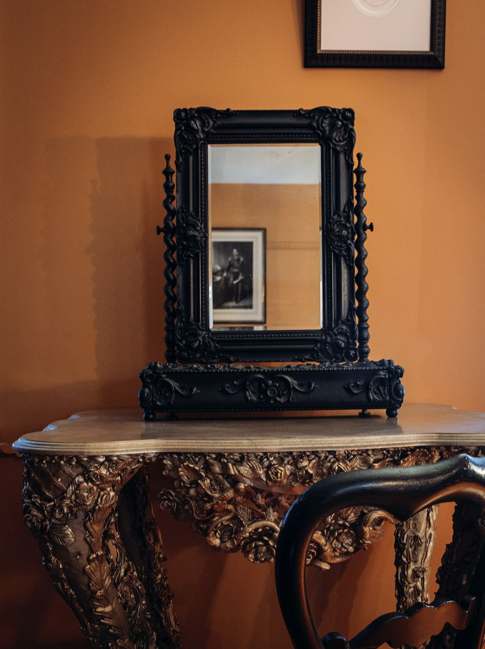 A part of Kate Rohde's Pheasant & Pangolin vitrine, the console table is made from polystyrene and epoxy resin. An early 19th century, elaborately carved dressing table mirror sits upon it.