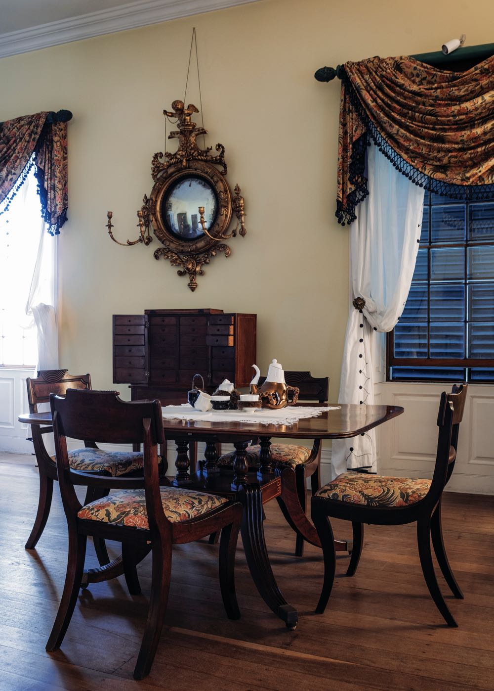 The music room of Old Government House contains a tale and chair setting for the taking of tea. Here Trent Jansen's 'Briggs Family Tea Service' finds it's natural place.