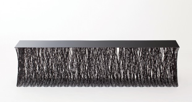 Ill Hoon Roh's 'Rami Paris' bench. A limited edition piece with carbon fibre sheet top resting on hundreds of hand worked interlocking carbon fibre struts.